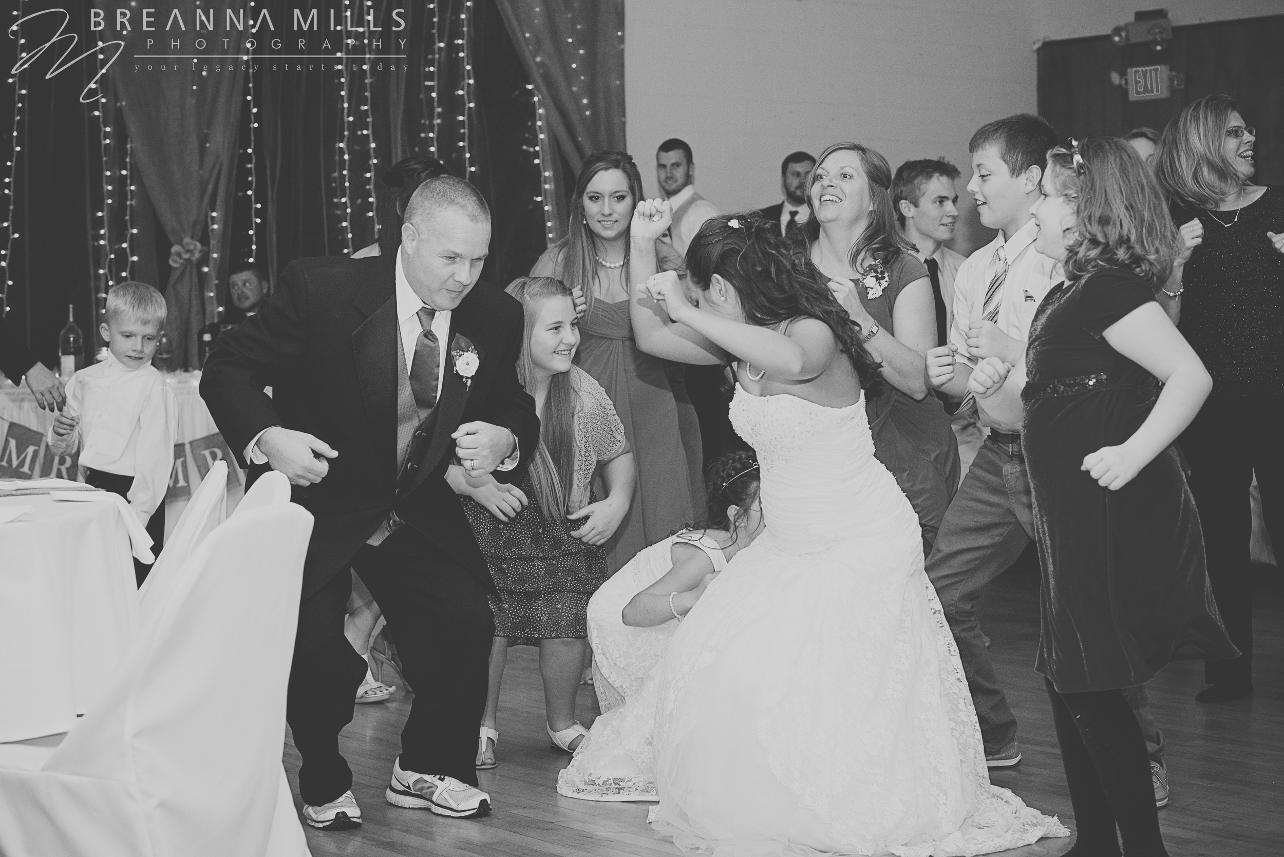 Johnson City wedding photographer, Breanna Mills Photography captures bride and father dancing during wedding reception.