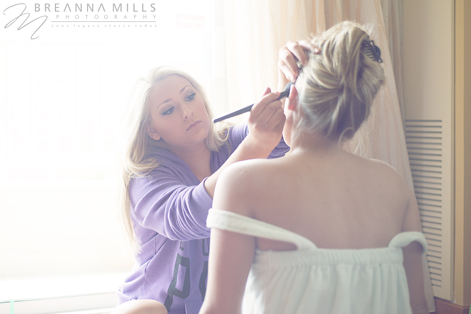 Johnson City wedding photographer Breanna Mills Photography captures bridesmaids getting ready for vineyard wedding at Meadowview Convention Center.  Preparing for wedding at the Corey Ippolito Winery wedding venue.