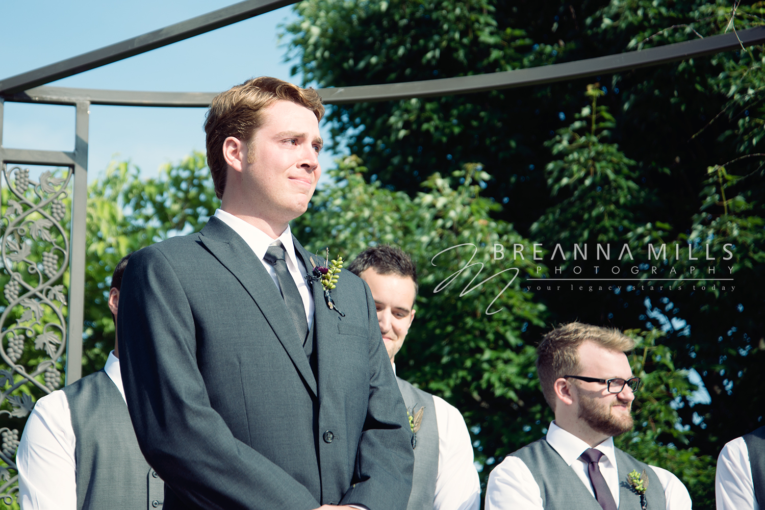 Groom watching his bride walk down the aisle at the Corey Ippolito Winery wedding venue on his wedding day.