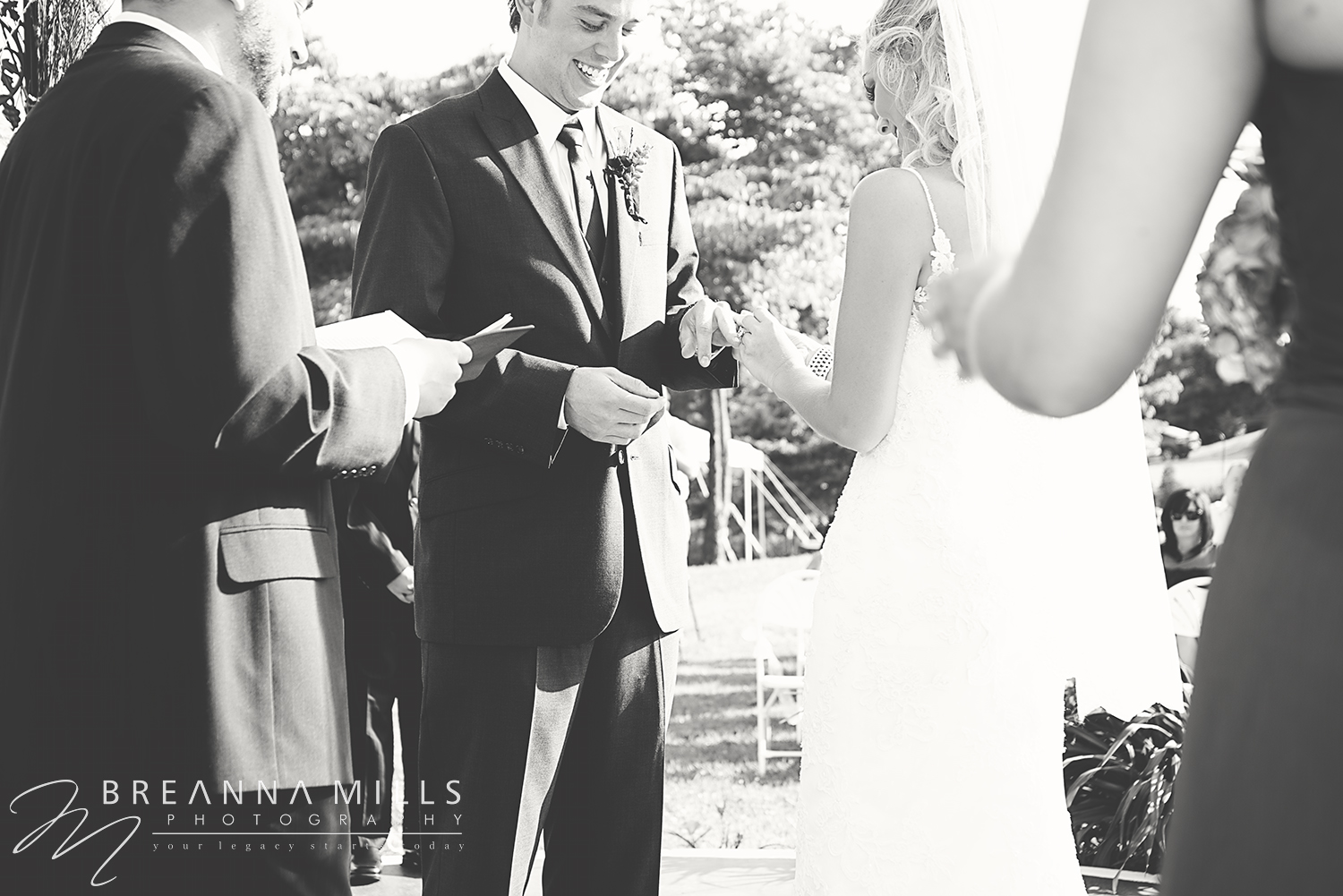 Bride and groom exchange wedding rings during ceremony on their wedding day at the Corey Ippolito Winery wedding venue.