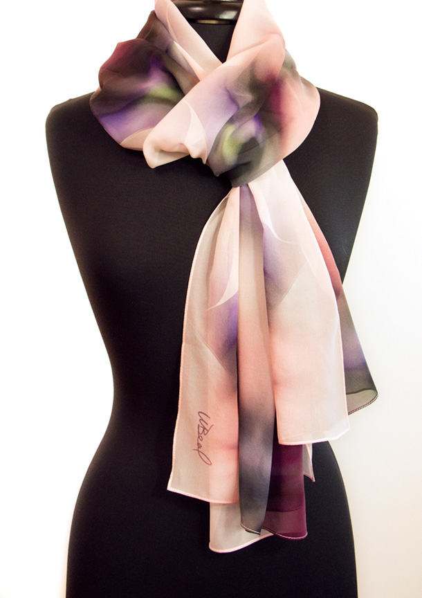 Just fold the scarf in half. Place it behind your neck and bring both ends to the front. Pull the loose ends through the loop, and voila! Easy and Elegant!