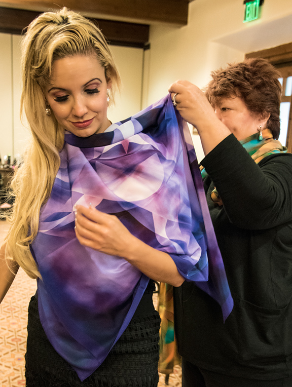 "Christy Vigil being fitted with Kathy Beal Signature scarf "" Blueberry Swirl "" from the  Urban Goddess Collection"
