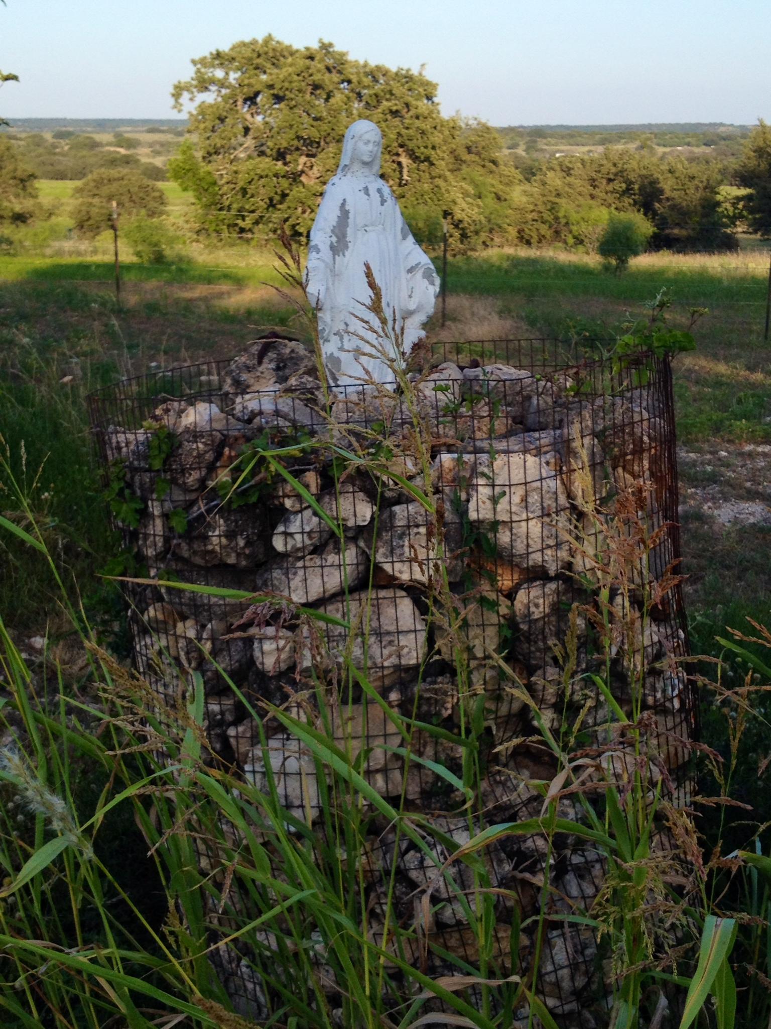 A faded Mary statue still overlooks the horizon