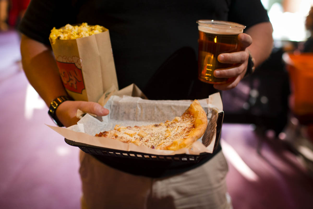 Beer, pizza, popcorn, and wine are just a few of the things that are available at the concession stand.