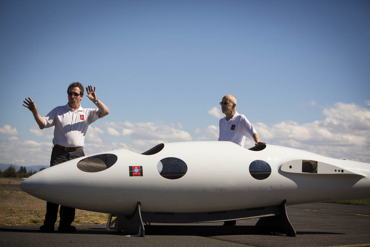 On Monday, September 16, 2013  Einar Enevoldson, (rt) Founder, Operations Director and chief pilot of The Perlan Project and Project Manager Morgan Sandercock (lt) display a dummy fuselage of their Perlan 2 glider at their facilities in Bend, OR. Their project consists of a team of scientists and aviation buffs that are creating a 2-seat glider with a 84 ft wing span, made of carbon fiber to reach a record altitude of 90,000 feet above the poles in 2015.  At this height  vast iridescent clouds of nitric acid and water vapor tear apart the ozone layer, and will give them the ability to study the Polar Votex.