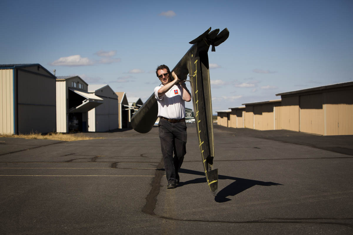 On Monday, September 16, 2013   The Perlan Project Manager Morgan Sandercock caries a test tail for the Perlan 2 glider at their facilities in Bend, OR. The project consists of a team of scientists and aviation buffs that are creating a 2-seat glider with a 84 ft wing span, made of carbon fiber to reach a record altitude of 90,000 feet above the poles in 2015.  At this height  vast iridescent clouds of nitric acid and water vapor tear apart the ozone layer, and will give them the ability to study the Polar Votex.