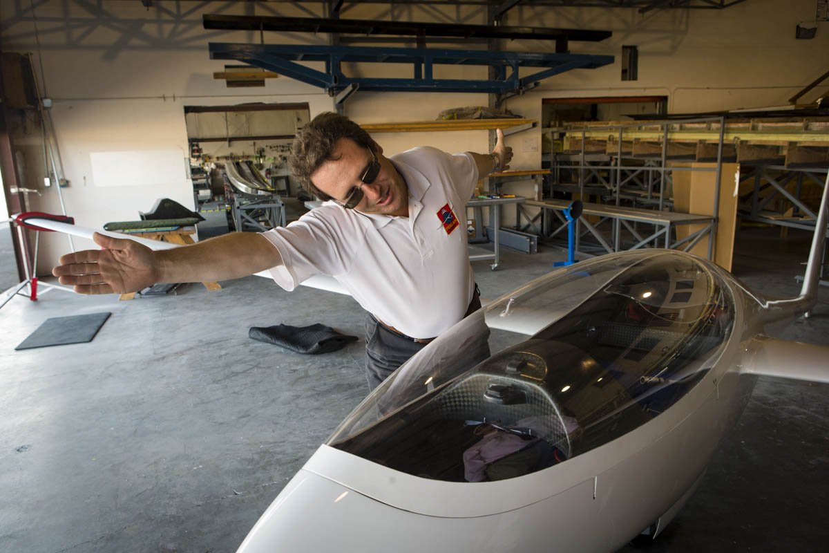 On Monday, September 16, 2013  Project Manager of The Perlan Project Mogan Sandercock looks at their National Champion DuckHawk glider at their facilities in Bend, OR.  The Perlan Project consists of a team of scientists and aviation buffs that are preparing a new 2-seat glider with a 84 ft wing span, made of carbon fiber,  that they plan to push to a record altitude of 90,000 feet above the poles in 2015.  At this height  vast iridescent clouds of nitric acid and water vapor tear apart the ozone layer, and will give them the ability to study the Polar Votex.
