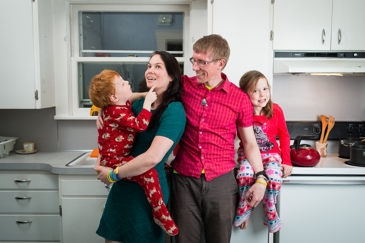 On Wednesday, January 8, 2014  Daniel Reeves (center rt) and Bethany Soule (center lt) pose for a portrait with their children Cantor Soule-Reeves (lt)  and Faire Soule-Reeves (rt) in their home in Portland, OR.  The couple are obsessed with fairness in their marriage and believe money is the greatest of equalizers.  So to settle who will be the one to put the kids to bed, or who gets the last brownie, they do an auction type negotiation that they named yootling, after the yootle, a hypothetical measurement of happiness. Each person holds up behind their back how much they would do the task for, then on 3 they show each other. Whoever has the lowest amount and therefore 'minds the least' does the deed and gets paid by the other person.