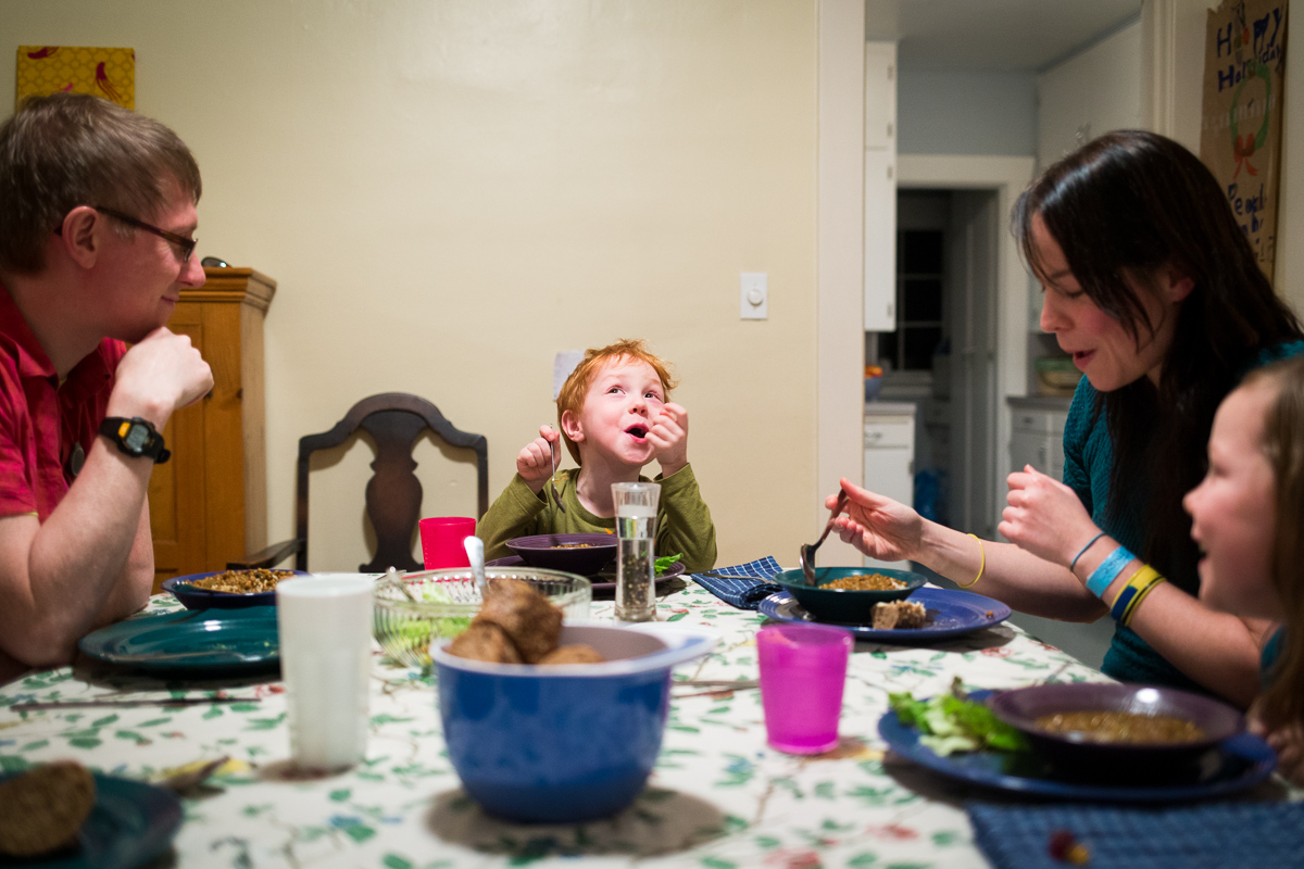 On Wednesday, January 8, 2014  Daniel Reeves (lt) and Bethany Soule (center rt) eat dinner with their children Cantor Soule-Reeves (center lt) and Faire Soule-Reeves (rt) in their home in Portland, OR.  The couple are obsessed with fairness in their marriage and believe money is the greatest of equalizers.  So to settle who will be the one to put the kids to bed, or who gets the last brownie, they do an auction type negotiation that they named yootling, after the yootle, a hypothetical measurement of happiness. Each person holds up behind their back how much they would do the task for, then on 3 they show each other. Whoever has the lowest amount and therefore 'minds the least' does the deed and gets paid by the other person. The couple, both with advanced degrees in cpmputer science run a startup called BeeMinder.
