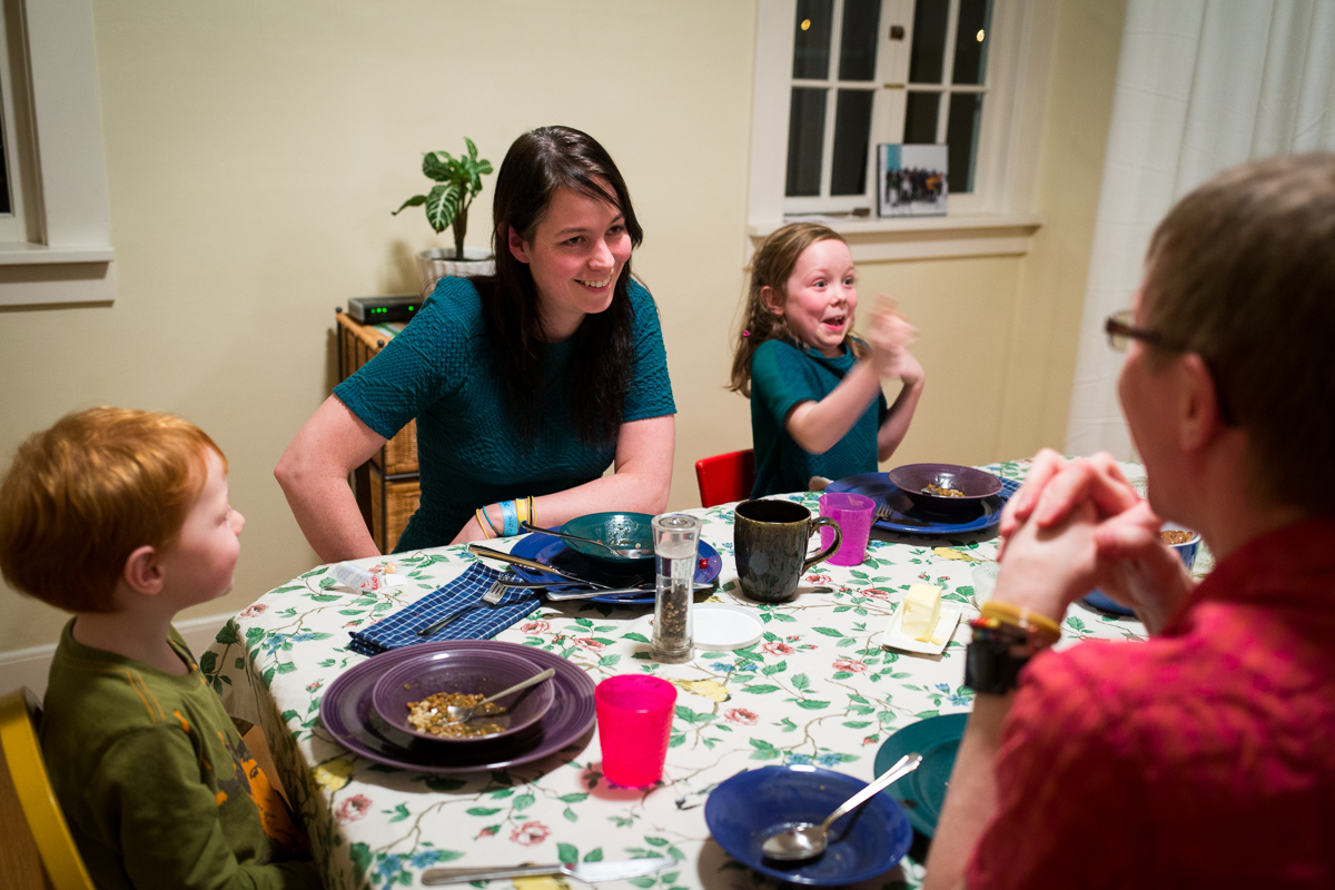 On Wednesday, January 8, 2014  Daniel Reeves (rt) and Bethany Soule (center lt) eat dinner with their children Cantor Soule-Reeves (lt) and Faire Soule-Reeves (center rt) in their home in Portland, OR.  The couple are obsessed with fairness in their marriage and believe money is the greatest of equalizers.  So to settle who will be the one to put the kids to bed, or who gets the last brownie, they do an auction type negotiation that they named yootling, after the yootle, a hypothetical measurement of happiness. Each person holds up behind their back how much they would do the task for, then on 3 they show each other. Whoever has the lowest amount and therefore 'minds the least' does the deed and gets paid by the other person. The couple, both with advanced degrees in cpmputer science run a startup called BeeMinder.