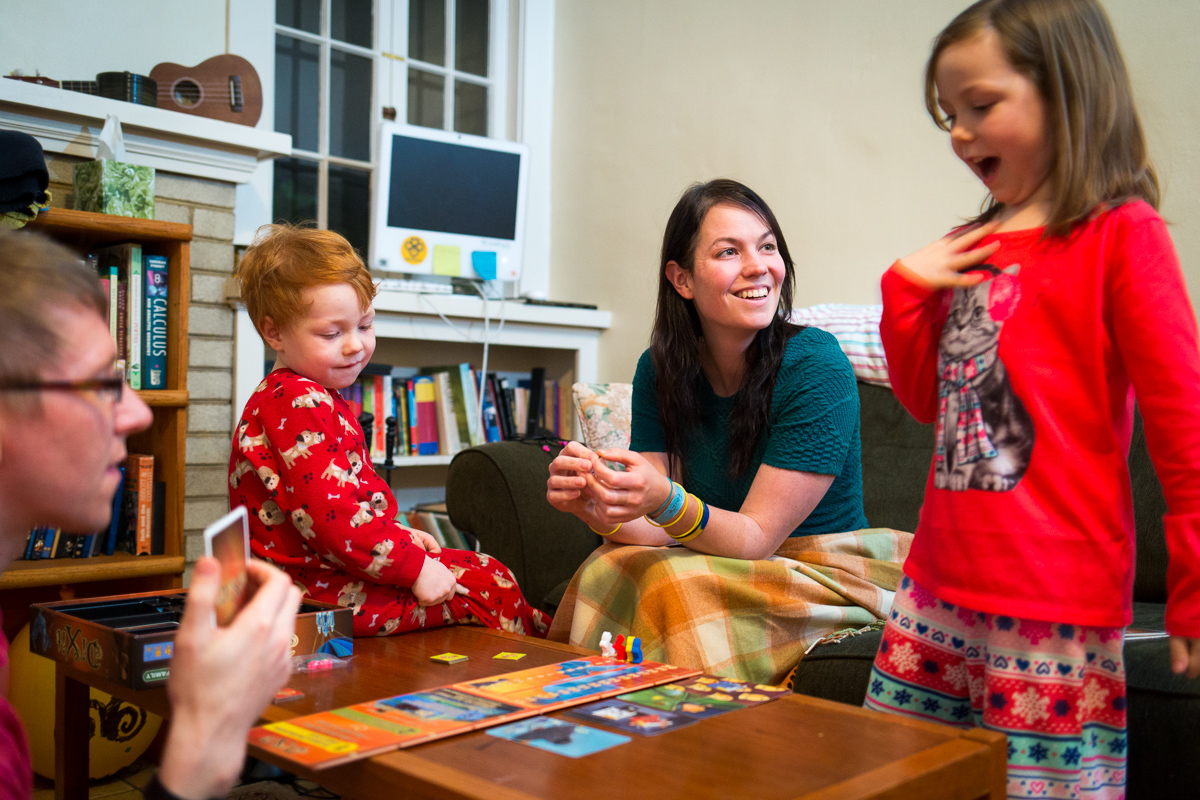 On Wednesday, January 8, 2014  Daniel Reeves (lt) and Bethany Soule (center rt) play a game with their children Cantor Soule-Reeves (center lt)  and Faire Soule-Reeves (rt) in their home in Portland, OR.  The couple are obsessed with fairness in their marriage and believe money is the greatest of equalizers.  So to settle who will be the one to put the kids to bed, or who gets the last brownie, they do an auction type negotiation that they named yootling, after the yootle, a hypothetical measurement of happiness. Each person holds up behind their back how much they would do the task for, then on 3 they show each other. Whoever has the lowest amount and therefore 'minds the least' does the deed and gets paid by the other person.