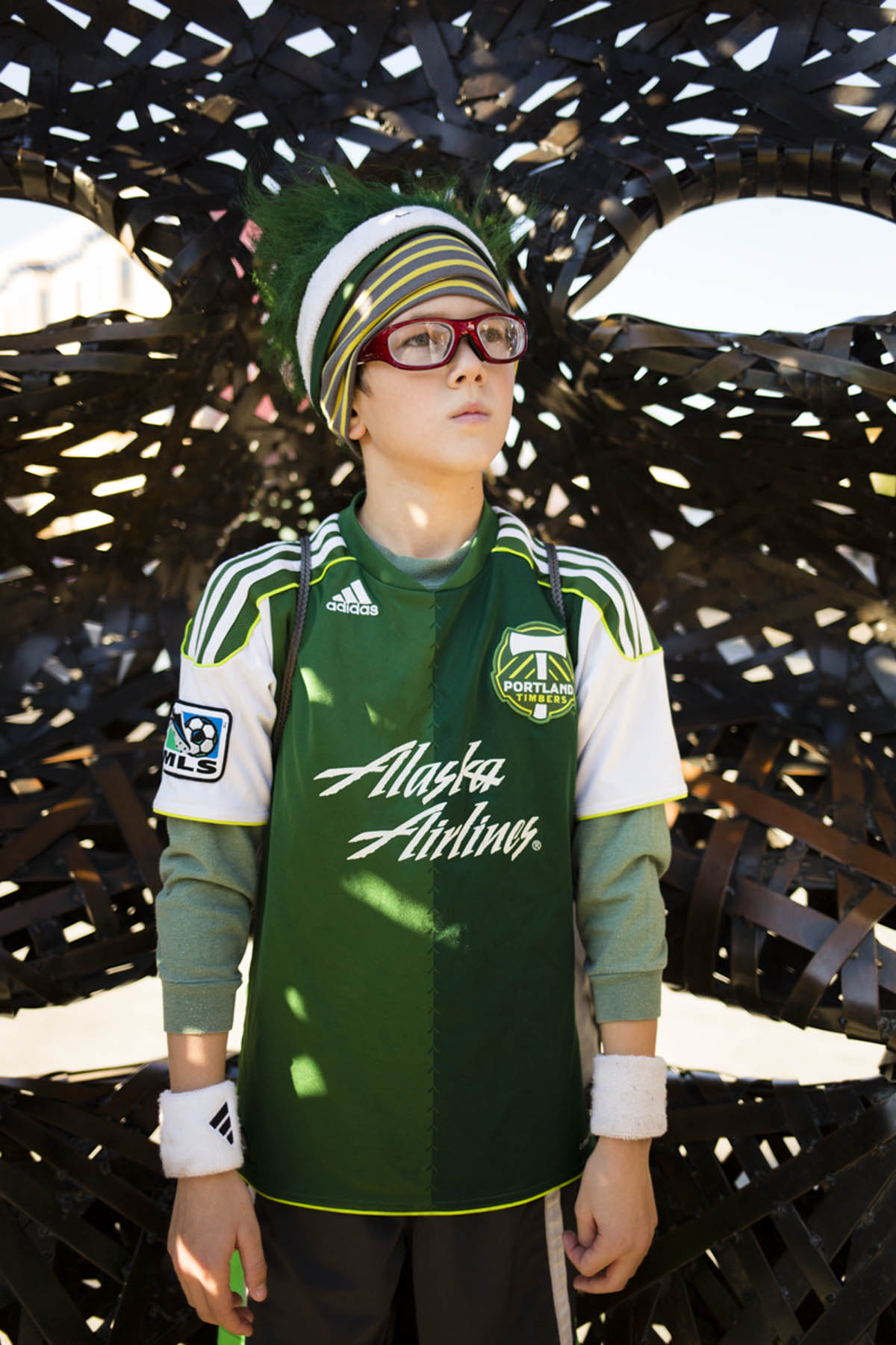 PORTLAND, OR – October 13, 2013:  Portland Timbers soccer fan Beck Waxman shows true colors (green) while posing for a portrait outside the Jen-Weld Field before a big game with rival to the North, the Seattle Sounders. The Timbers are one of the three hottest franchises in MLS right now, all part of a soccer explosion in the Pacific Northwest, including the Seattle Sounders and the Vancouver Whitecaps.