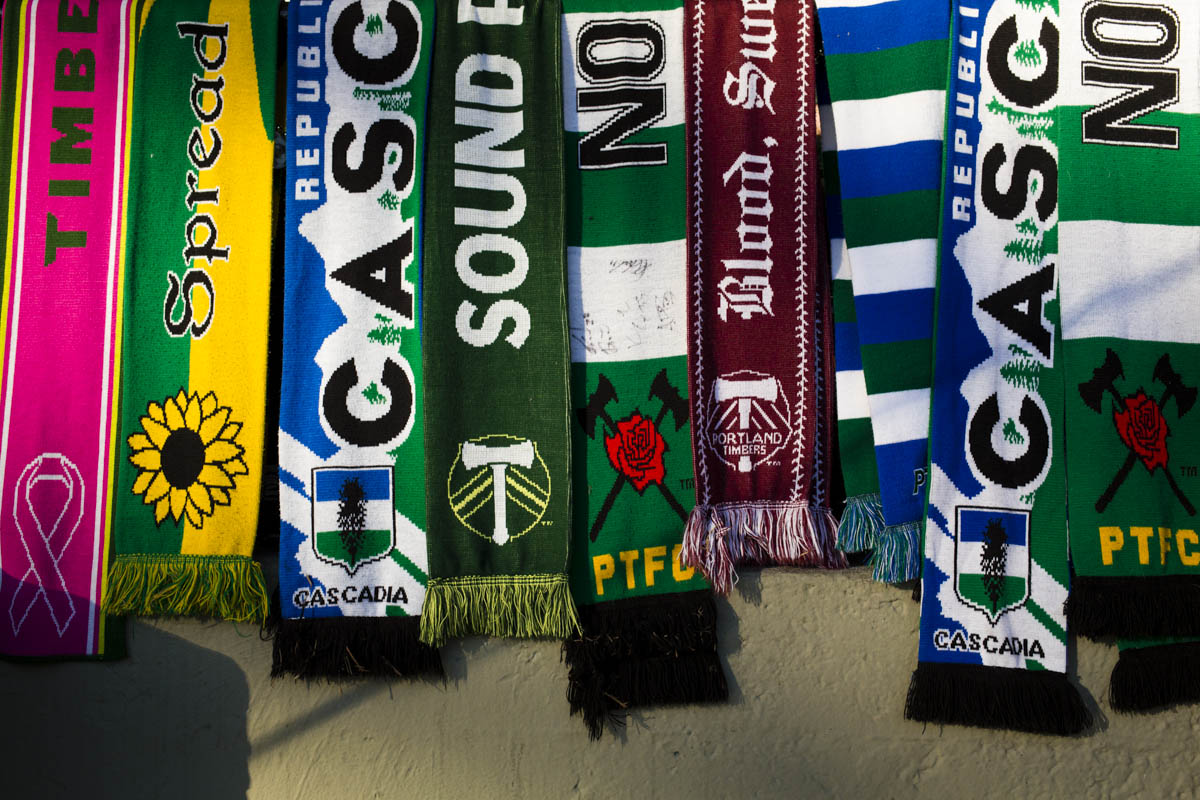 PORTLAND, OR – October 13, 2013:   Portland Timbers soccer fan decorate their area at Jen-Weld Field with scarves before the big game with their rivals to the North, the Seattle Sounders.  The Timbers would go on to win the game 1 to 0. One of the three hottest franchises in MLS right now, the Timbes are part of a soccer explosion in the Pacific Northwest, including the Seattle Sounders and the Vancouver Whitecaps.