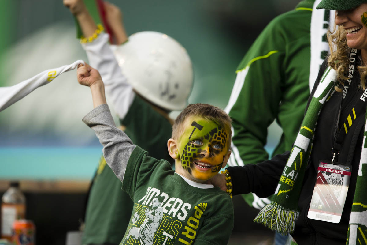 PORTLAND, OR – October 13, 2013:  junior Portland Timbers soccer fan Joshua Grahm cheers on this team at the Jen-Weld Field before the big game with their rivals to the North, the Seattle Sounders. The Timbers would go on to win the game 1 to 0. One of the three hottest franchises in MLS right now, the Timbes are part of a soccer explosion in the Pacific Northwest, including the Sounders and the Vancouver Whitecaps.