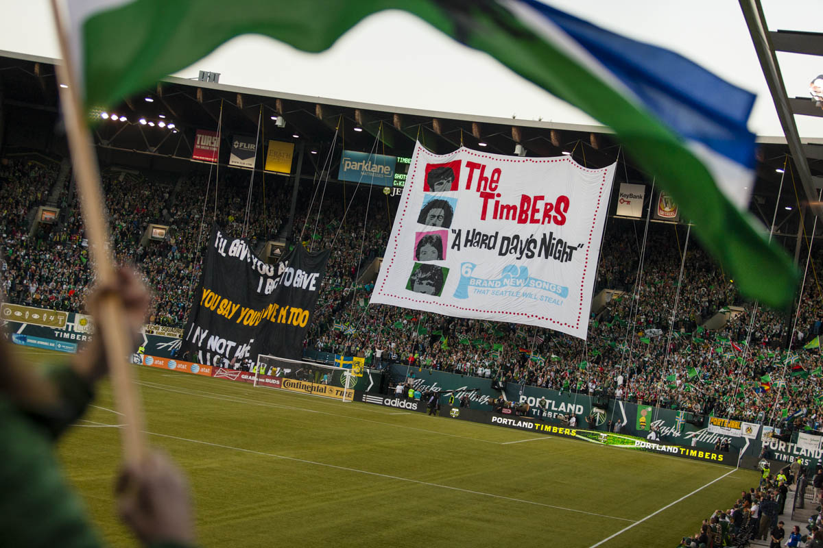 PORTLAND, OR – October 13, 2013:  Portland Timbers soccer fans unveil a tifo display (funded from procceeds from the Timber Merch van) at the Jen-Weld Field before the big game with their rivals to the North, the Seattle Sounders. The Timbers would go on to win the game 1 to 0. One of the three hottest franchises in MLS right now, the Timbes are part of a soccer explosion in the Pacific Northwest, including the Seattle Sounders and the Vancouver Whitecaps.