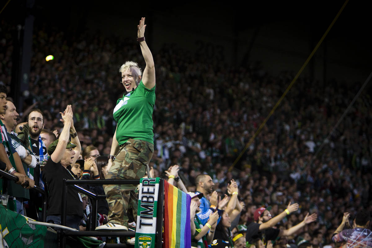 PORTLAND, OR – October 13, 2013:  a Portland Timbers Army Capo leads the chants and cheers at the Jen-Weld Field during the big game with their rivals to the North, the Seattle Sounders. The Timbers would go on to win the game 1 to 0. One of the three hottest franchises in MLS right now, the Timbes are part of a soccer explosion in the Pacific Northwest, including the Sounders and the Vancouver Whitecaps.