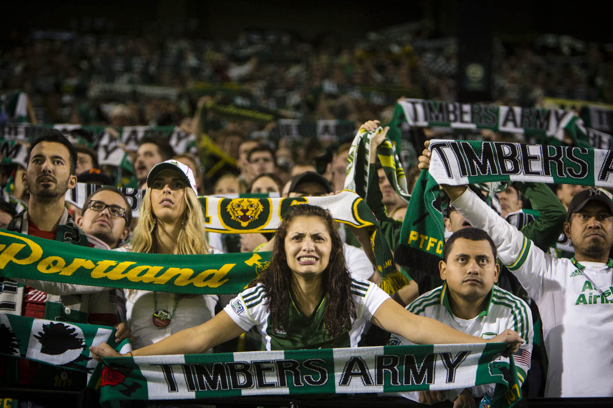 PORTLAND, OR – October 13, 2013:  a Portland Timbers Army fans watch anxiously as the clock ticks down on a close game with their rivals to the North, the Seattle Sounders.  The Timbers would win the game 1 to 0. One of the three hottest franchises in MLS right now, the Timbes are part of a soccer explosion in the Pacific Northwest, including the Sounders and the Vancouver Whitecaps.