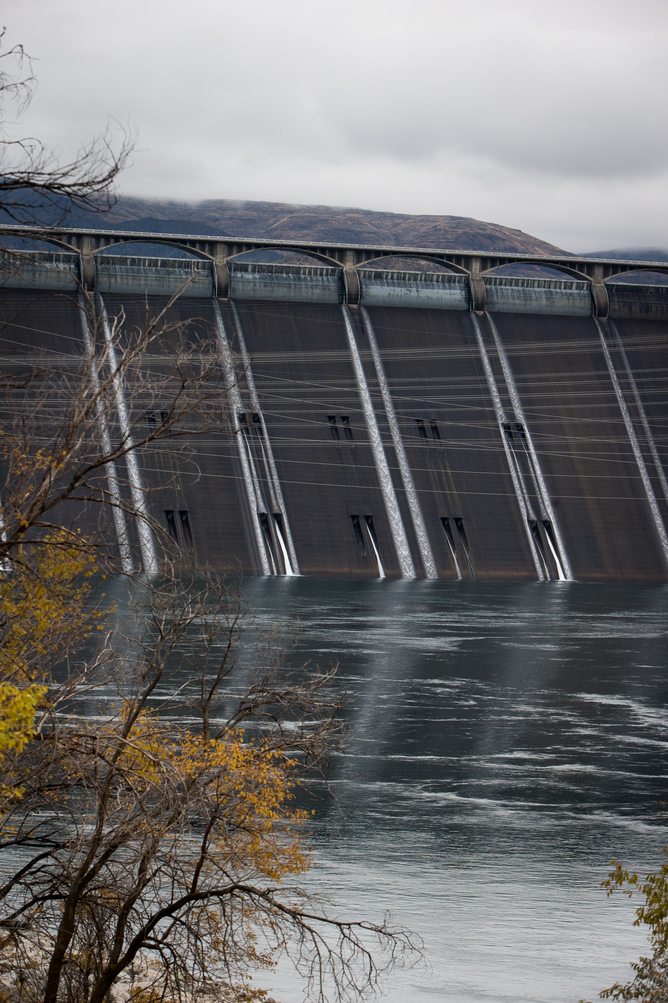 Coulee Dam, WA - November 10th, 2013: The Grand Coulee Dam began operating in 1942 and is one of the world's largest concrete structures.  Over a mile long when constructed it had a peak workforce of 7,700 and took a little over 9 years to complete.  In 1941 Woody Guthrie worked for the Bonneville Power Administration (the federal agency created to sell and distribute power from the river's federal hydroelectric facilities, in particular the Bonneville Dam and Grand Coulee Dam) for a single month, creating 26 or so songs called the Columbia River Ballads, including a song devoted to the dam called 