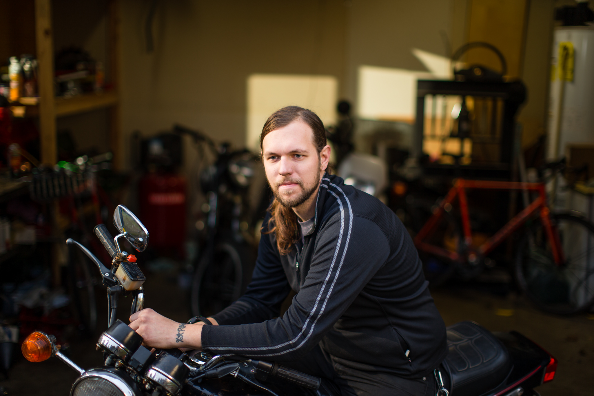 On Saturday, December 6, 2014 Tom Daly, owner of WTF Bikes, poses for a portrait on one of his new motorcycles at his home in Millwaukie, OR. A year ago Daly considered himself invincible and decided not to buy health insurance.  
