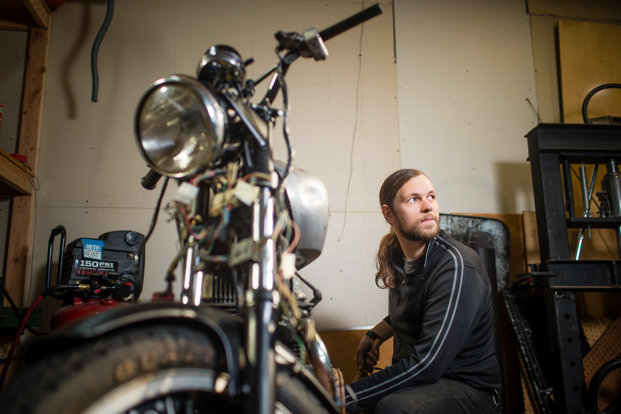 On Saturday, December 6, 2014 Tom Daly, owner of WTF Bikes, works on one of his new motorcycles at his home in Millwaukie, OR. A year ago Daly considered himself invincible and decided not to buy health insurance.  