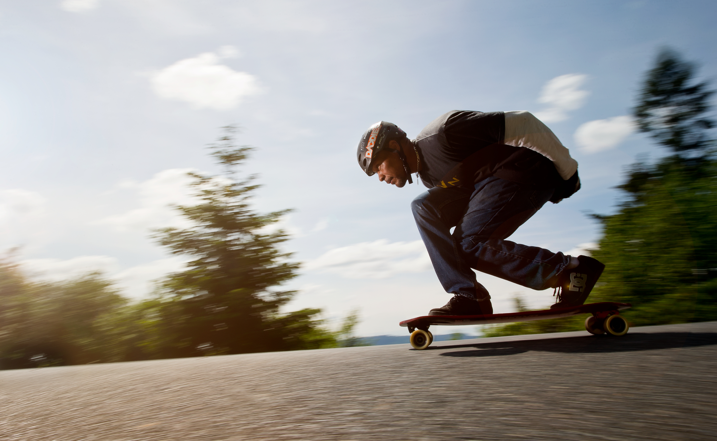 Daron Horwitz, president of Daddies Board Shop, takes his longboard for a ride on Mt. Tabor, Portland Oregon.