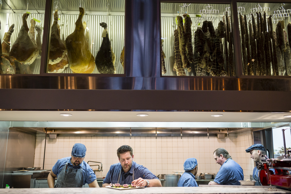 On November 5th, 2015 dinner prep is underway at Valette, started by local brothers, Chef Dustin Valette (pictured here, center, no hat) and front of the house man Aaron Garzini in Healdsburg, CA inside a building once owned by Valette's grandfather, Honore. The innovative restaurant, known for its hand cured meats is located in the heart of Sonoma, a 1768-square mile county chocked full of wineries, dairies, micro-distilleries, bakeries, restaurants, gardens, and orchards that is quickly becoming known as the food-iest place on earth.