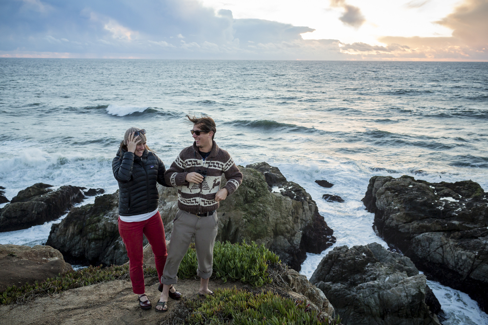 On November 9th, 2015 Alison Bender (girl, hat) and Sean Williams (boy, brown seater), visitors from Alaska, fight the wind to watch the sunset over the Pacific Ocean at Bodega Head, a small rocky promontory on the Pacific coast of northern California in Sonoma County that shelters Bodega Bay.