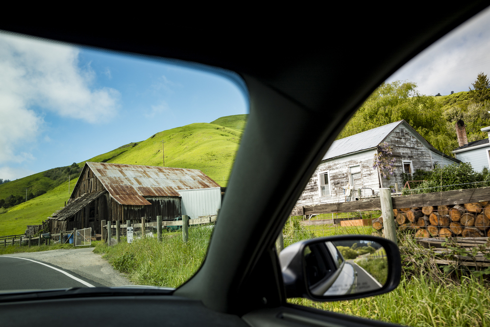 On March 31st, 2016 excellent views of verdant rolling hills and ancient farm houses can be seen along Highway 116 in between Duncan Mills and Jenner following the Russian River in Sonoma County.