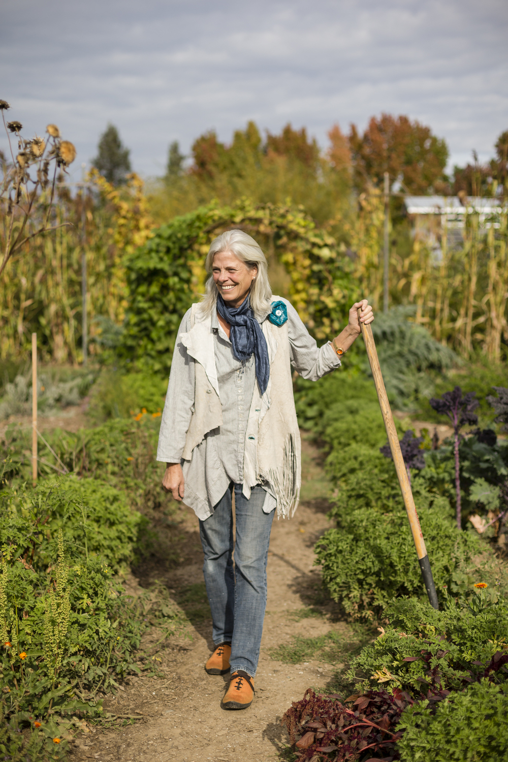 On November 5th, 2015 in Healdsburg, CA, Colleen McGlynn, walks through the gardens at the tasting room property of DaVero Farms & Winery which she owns with husband and QuickBooks creator Ridgely Evers.  DaVero is a biodynamic family farm which produces small lots of Italian wine and olive oil in the Dry Creek Valley of Sonoma County. Sonoma has become America's test kitchen, 1768-square miles chocked full of wineries, dairies, micro-distilleries, bakeries, restaurants, gardens, and orchards.