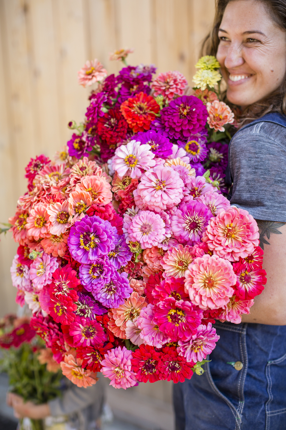 On November 6th, 2015 in Healdsburg, CA, Zoe Hitchner, flower grower at Front Porch Farm, poses for a portrait with flowers from the farm's vibrant garden which includes more than 60 varieties of annuals.  Owned by Mimi and Peter Buckley, the Russian River runs through the valley of their 110-acre biodynamic farm which focuses on biodiversity and the health and vitality of the land.  The farm also grows a variety of fruits and vegetables, as well as heirloom wheat and wine grapes. 