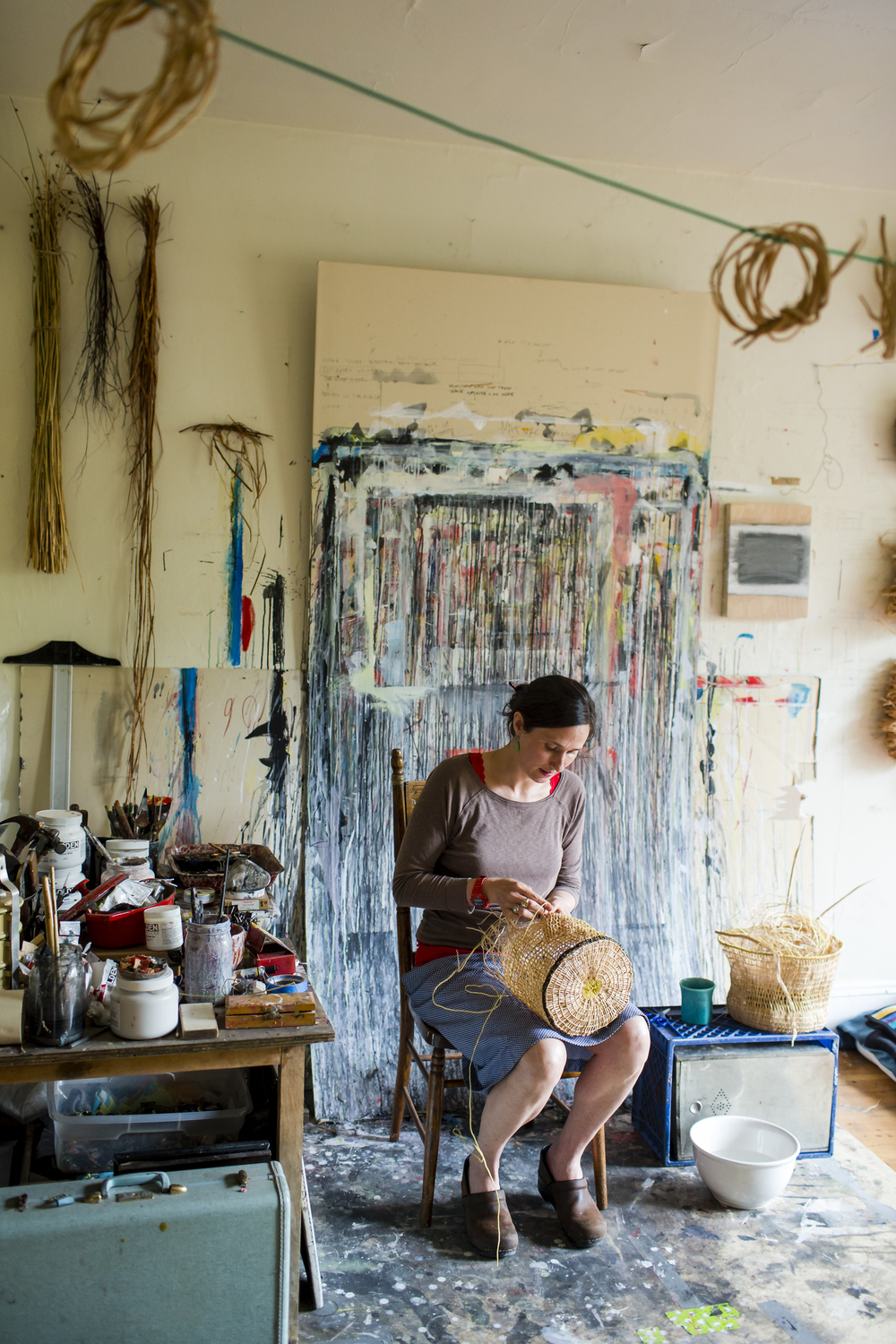 On Tuesday, May 12th 2015 Artist and Educator Sara Siestreem (Hanis Coos and American, 1976-) works on a basket at her home and studio in Portland, OR.  Siestreem is from the Umpqua River Valley in southwestern Oregon. Siestreem graduated Phi Kappa Phi with a BS from PSU in 2005. She earned an MFA with distinction from Pratt Art Institute in 2007. She is represented by Augen Gallery in Portland and her work has been shown in museums and figures in prestigious private and public collections nationally. She teaches studio arts at PSU and Tribal Museum Studies for Northwest Indian College. She serves as a consultant and free lance educator for museums and cultural groups regionally. Siestreem also serves various youth organizations and individuals in the role of mentor, workshop leader, promoter, public speaker and volunteer.