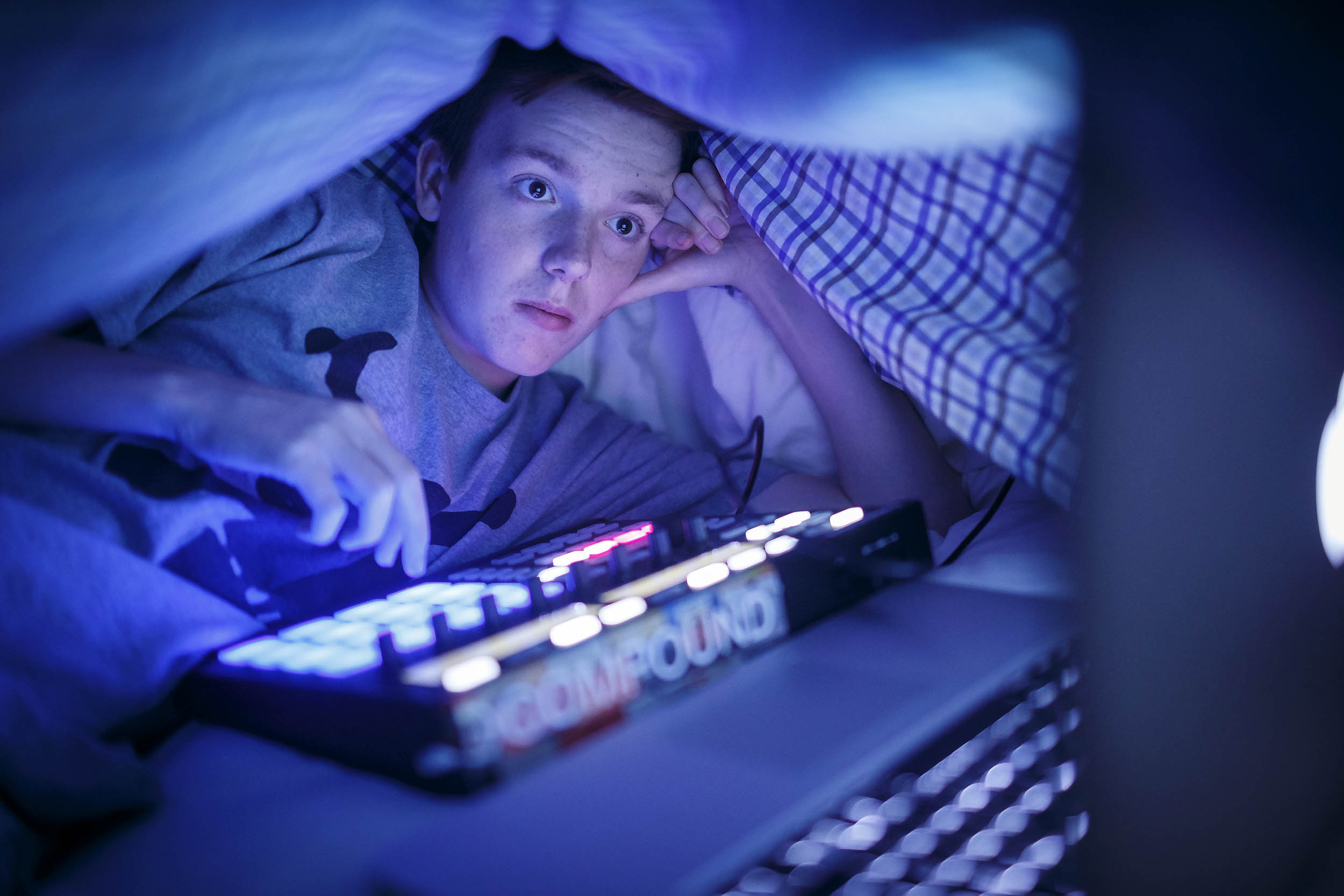 """In his bedroom at night Owen Lanahan, age 15, make beats, watches Youtube video, and texts his friends under the covers to hide from his mom. He says he will stay up until around 2am once or twice a week doing this. Currently there is a term for this called """"vamping"""" where kids will stay up all night on their computers and social media. The New York Times"""