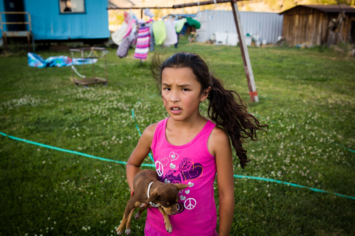 Kahmussa Green, 7, plays in the yard of her home in Warm Springs, OR. Adopted by her mother, Charlie Green, her name means respect. Born to an addicted mother, this lover of ballet spent the first days of her life going through withdrawal. Project Dayshoot.