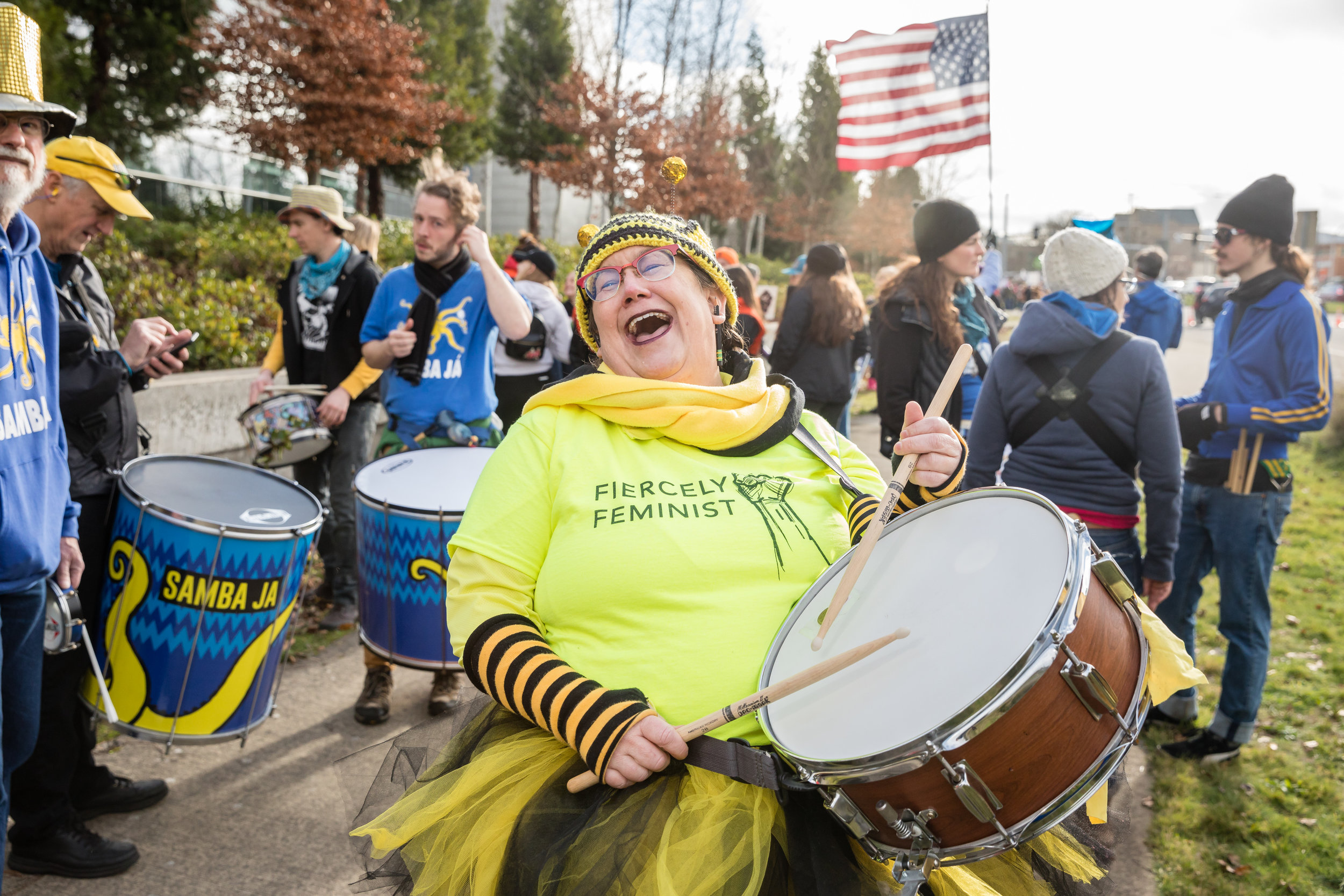 """Approximately 3,000 people marched in the second annual Women's March for Action in downtown Eugene, OR. Cecelia Honey, 50 from Eugene who was leading the march with the Brazillian percussion ensemble, Samba Ja. She's here, """"To protest the psychopath in DC and let him know we are not going to sit down and take it."""" For women in 2018 she said, """"I want to end this rape culture."""" The New York Times."""