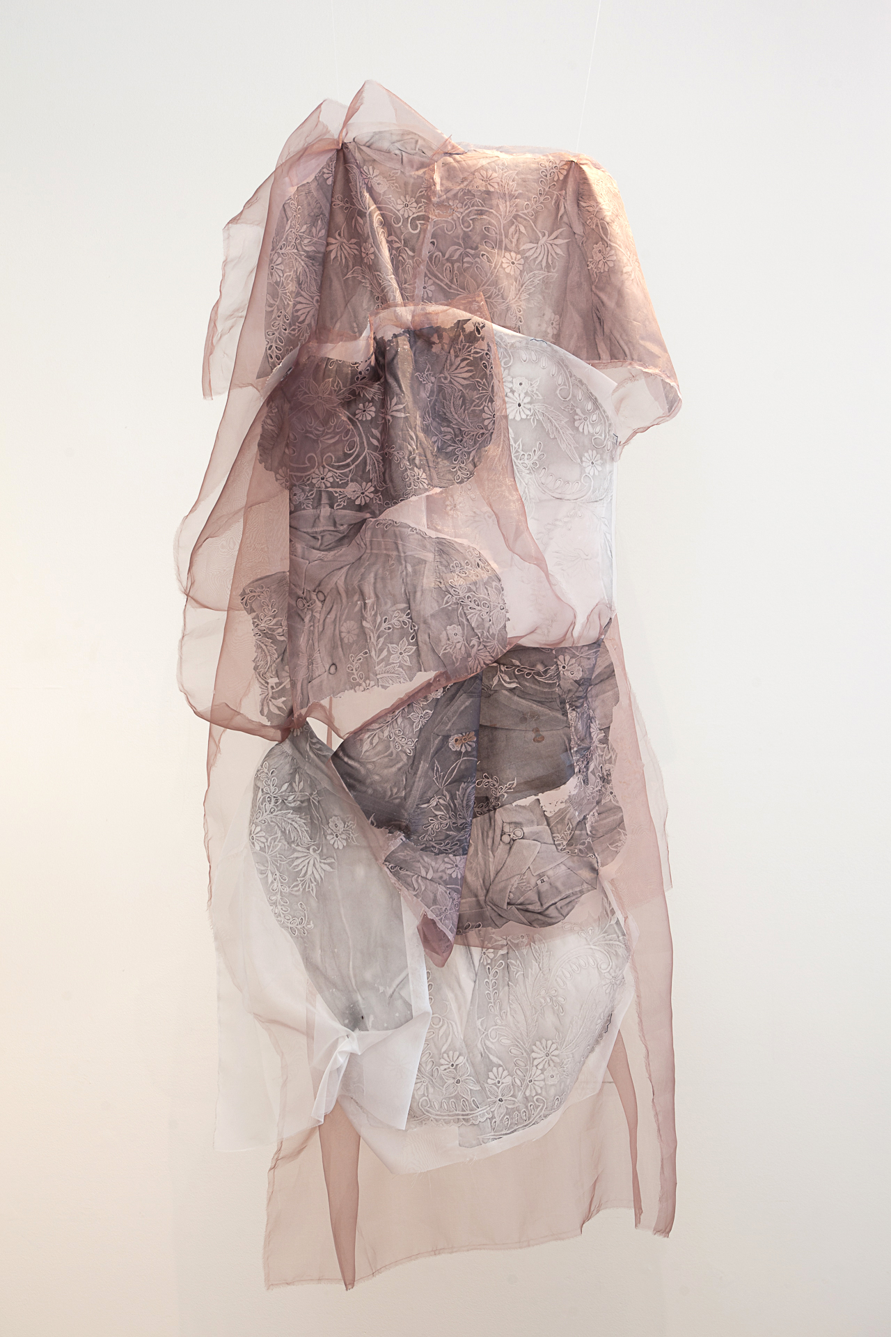"""Imahe , 2015  Image transfers on synthetic organza sewn together, approx. 60"""" x 24""""(Photo: Mido Lee)"""