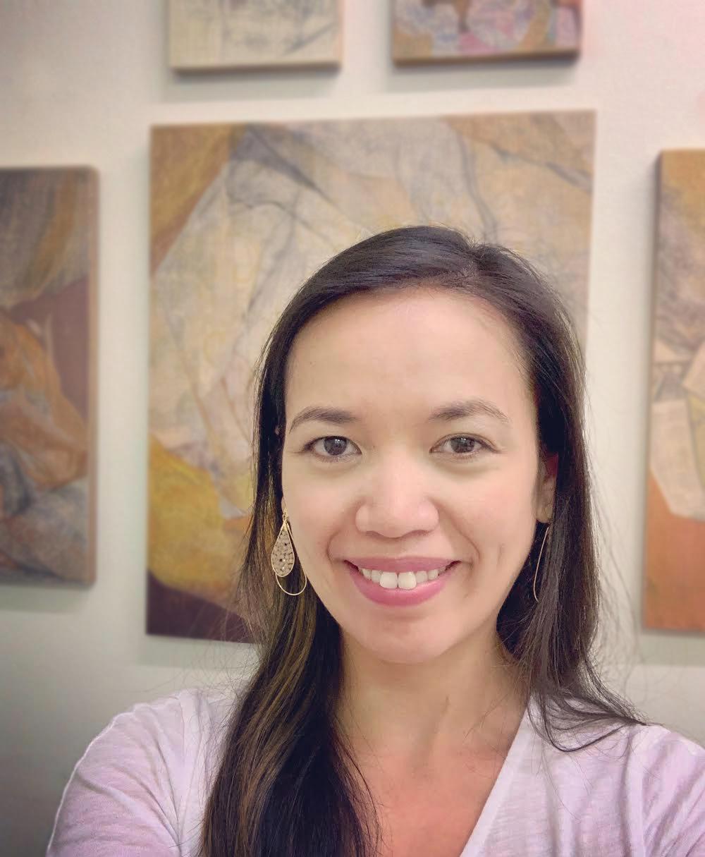 Rea Lynn de Guzman in front of her work.