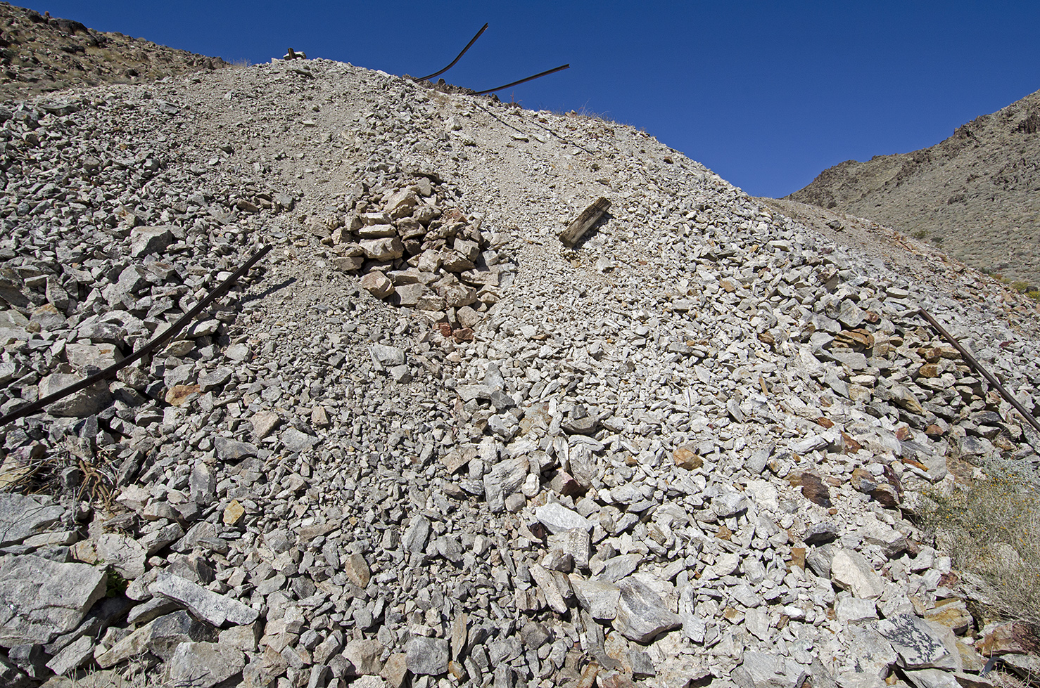 The big tailings pile with the ore cart tracks hanging off the edge.
