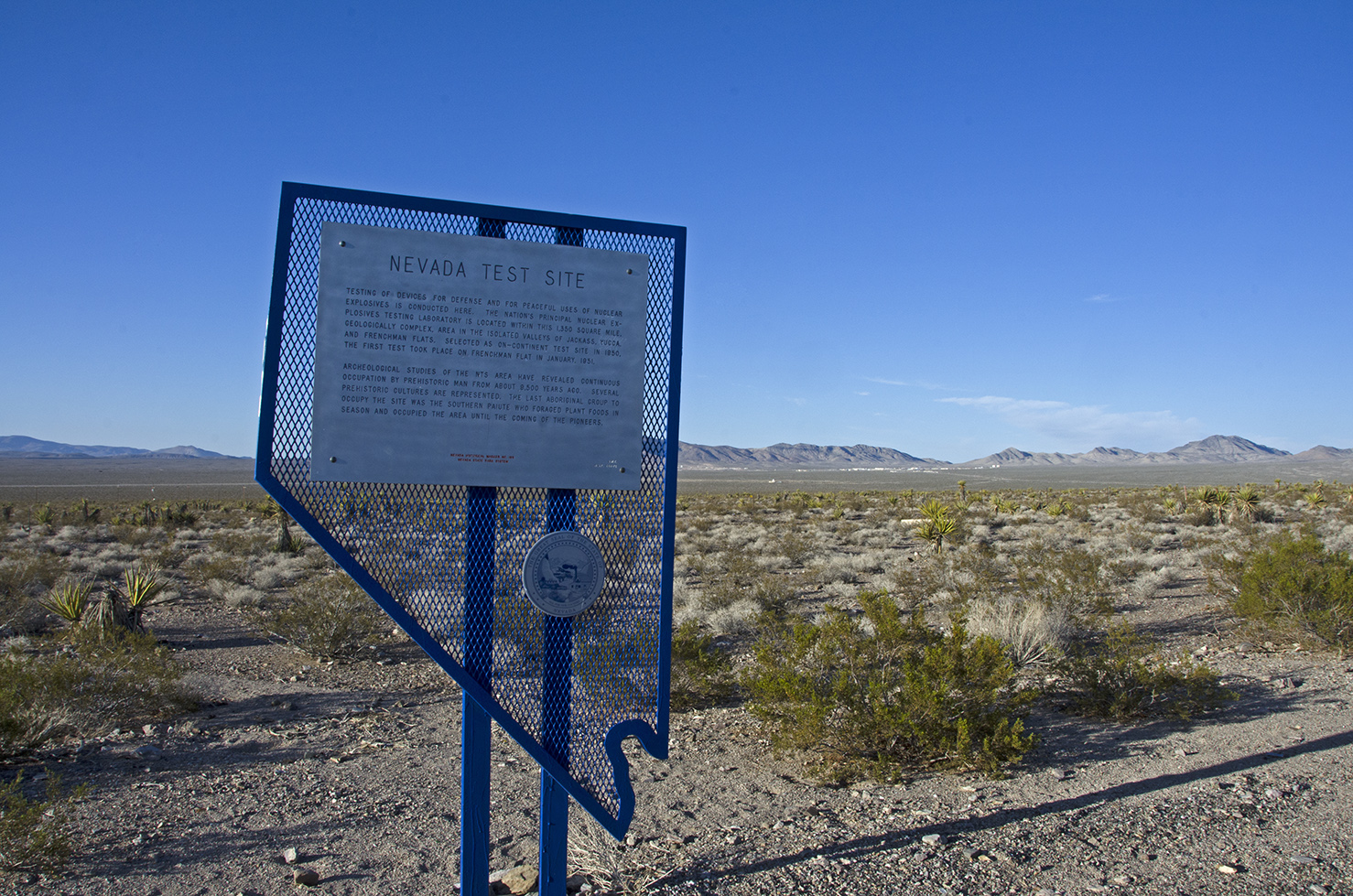 The historic marker at the side of the road.