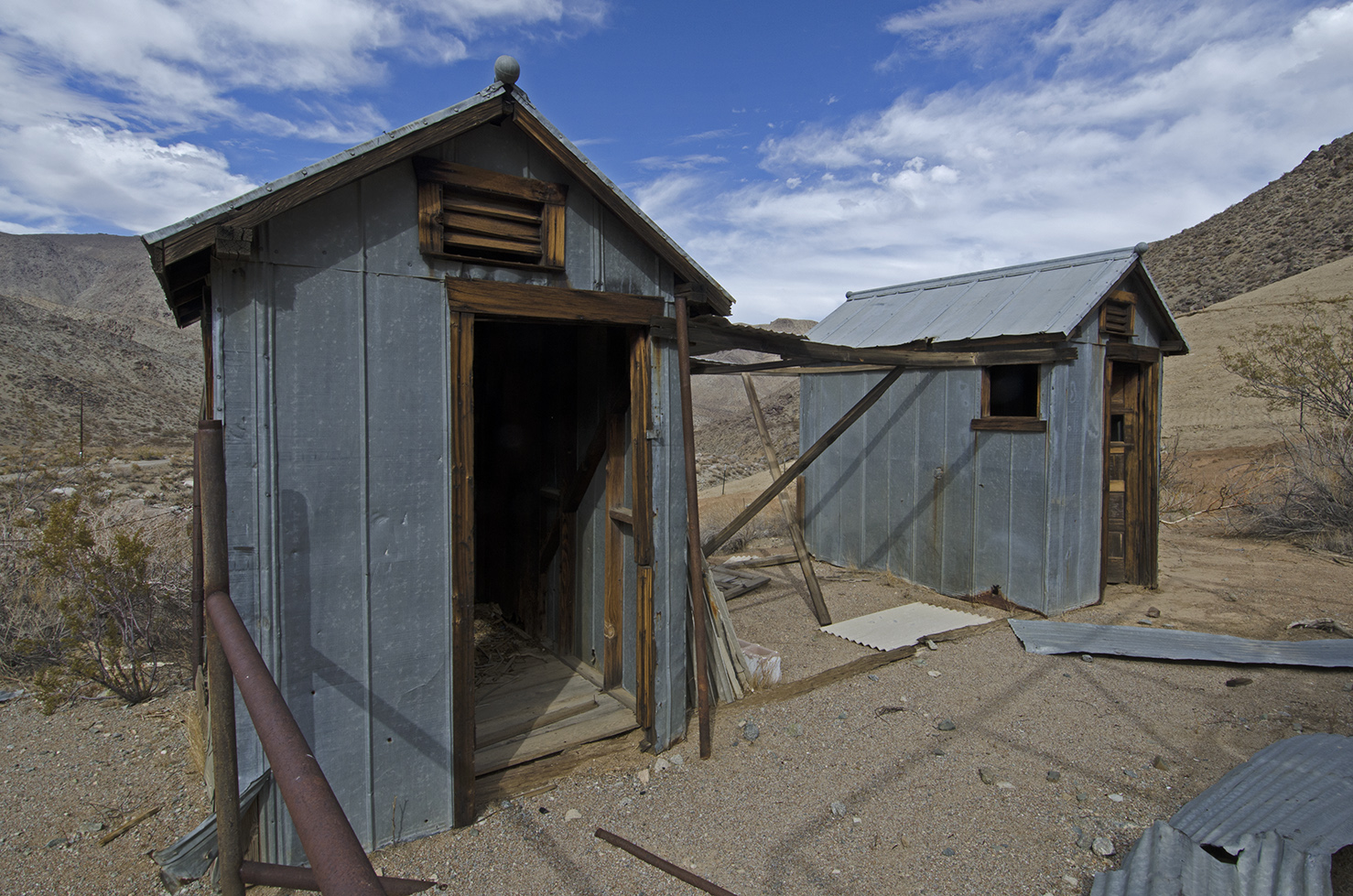 A pair of outhouses. His and hers?