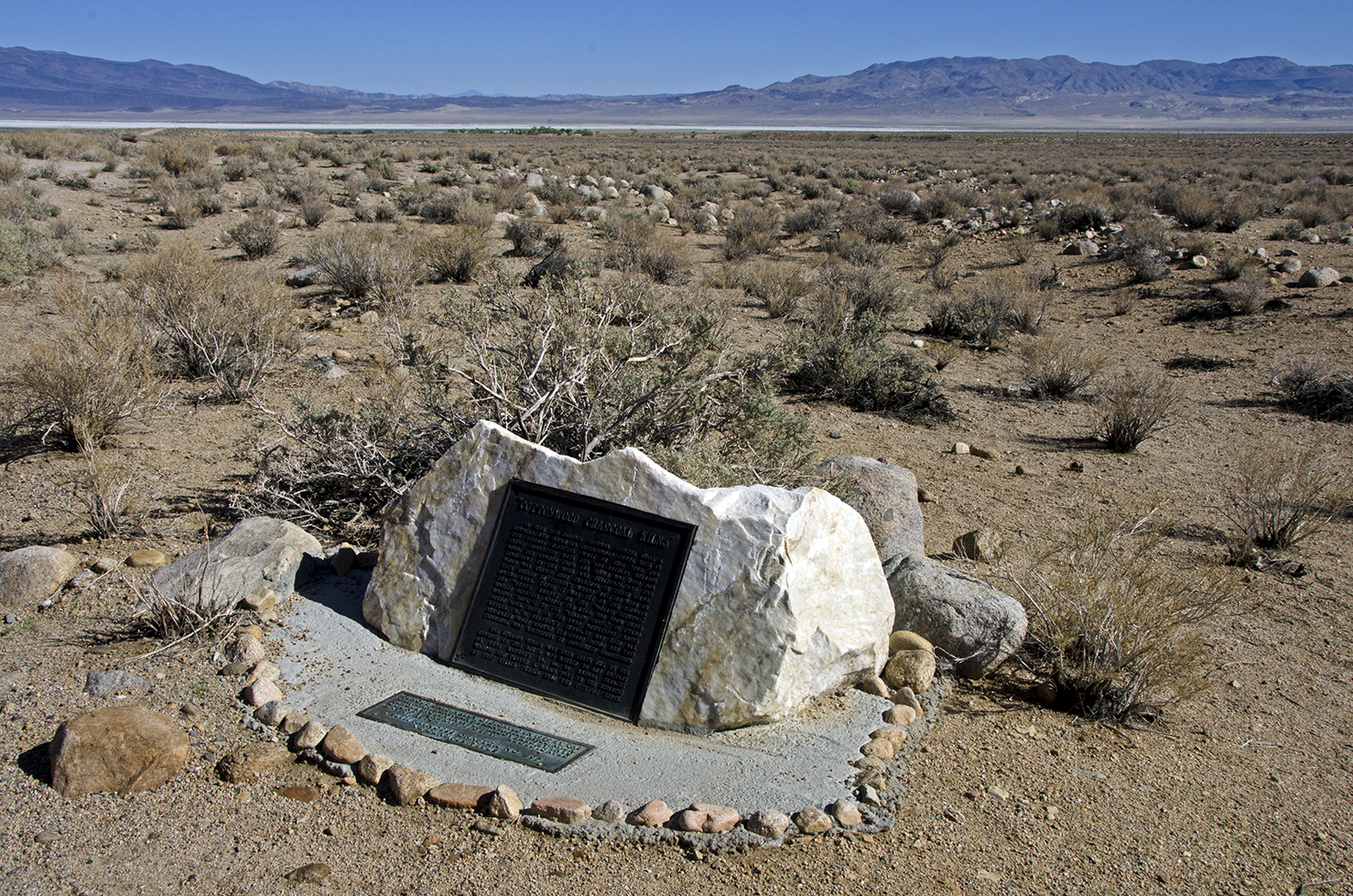 Cottonwood Charcoal Kilns Monument. Dry Owens Lake Bed in the distance.