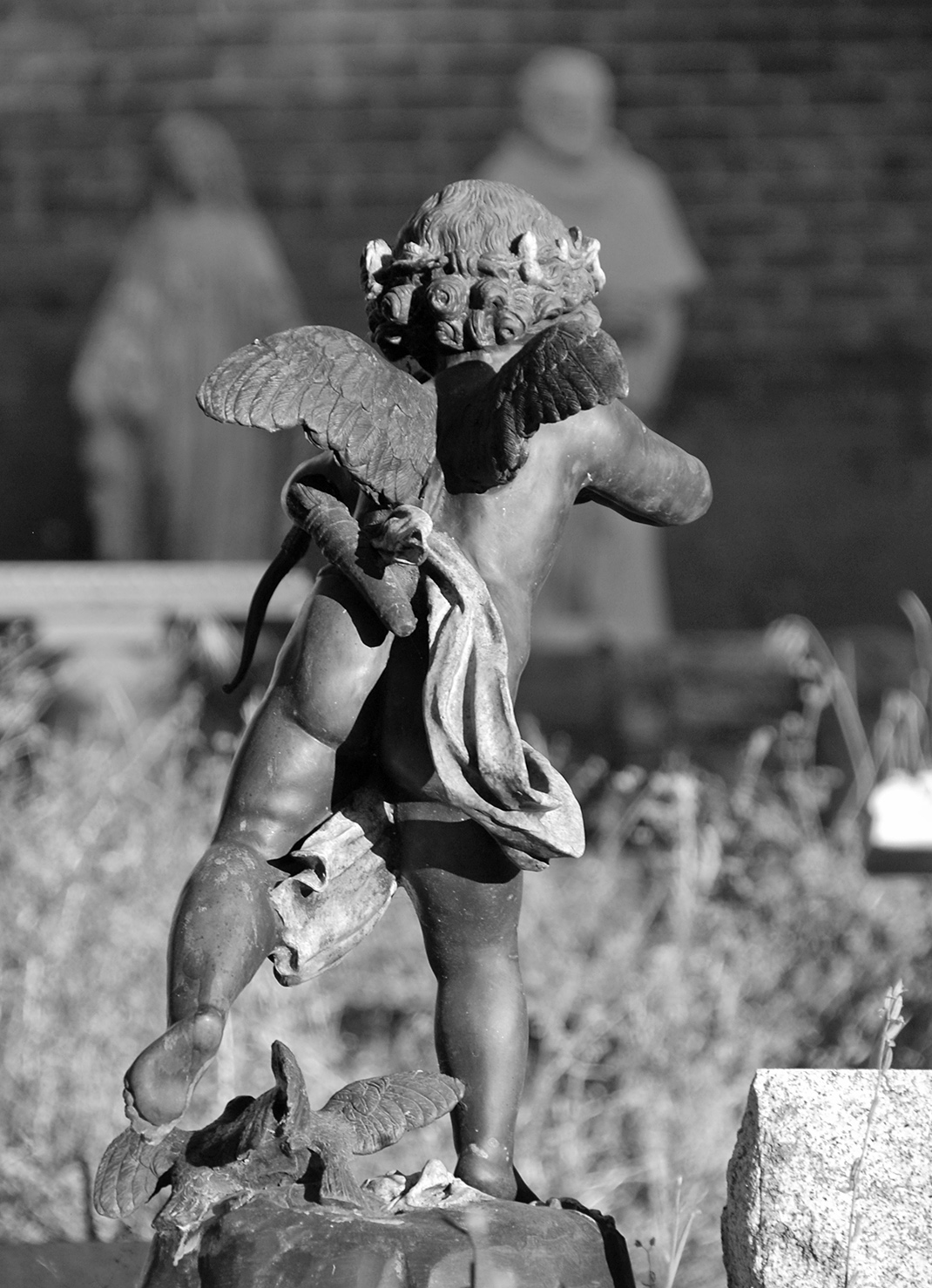 Columbia St. Annes Catholic Church Cemetery Winged Cupid.jpg
