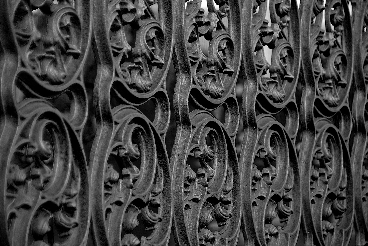 Wrought iron detail of grave enclosure.