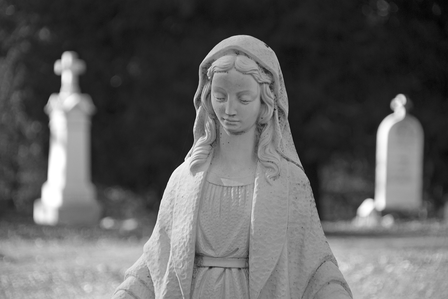 Mariposa St. Josephs Catholic Cemetery Lady and stones.jpg