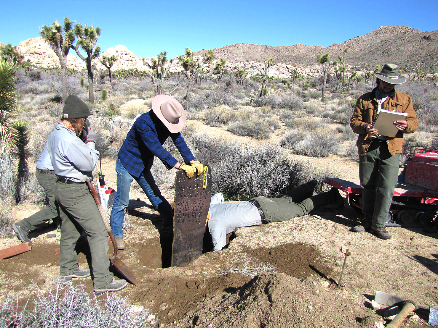 Park personnel placing the replica Bagley marker along the trail to the Wall Street Mill……nps photo