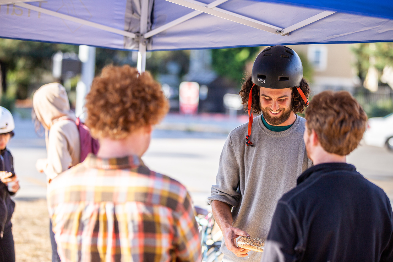 No shortage of smiles and bagels at last fall's Bike to Work Day at UCSC's main entrance. Photo courtesy Ecology Action.