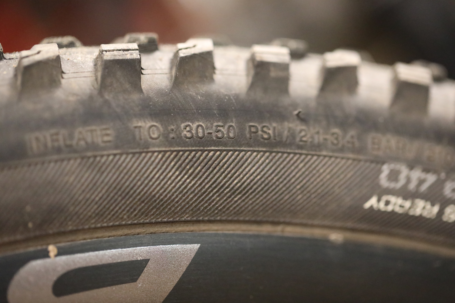 For this tire, the acceptable pressure range is 30-50 psi. It's helpful to have a pump with a dial at home.