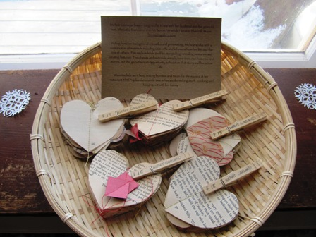 Heart Garlands by Michele Levesque.  These gorgeous garlands are made from recycled book pages and origami paper, sewn with cotton thread.