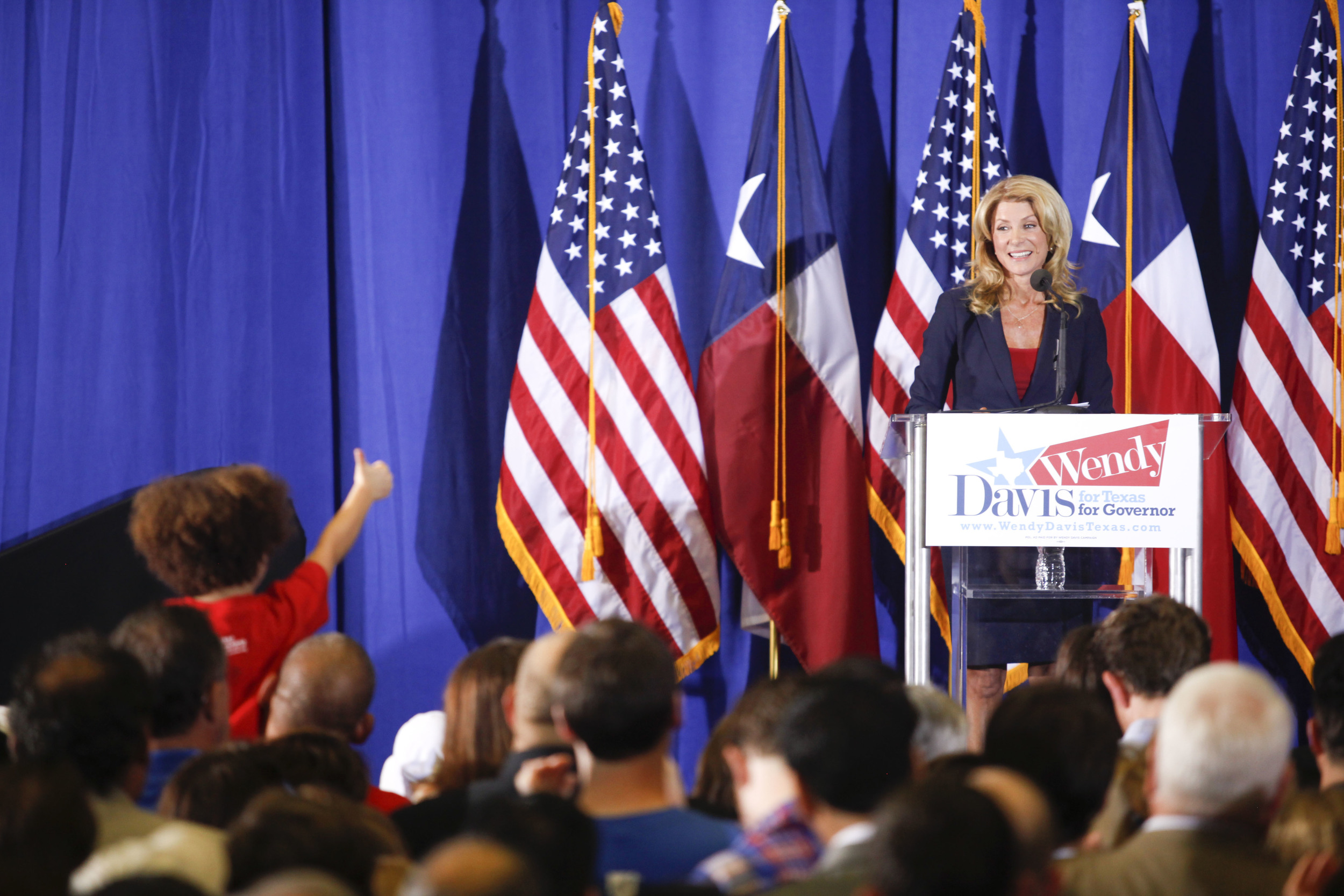 A young fan gives Sen. Wendy Davis the thumbs up.