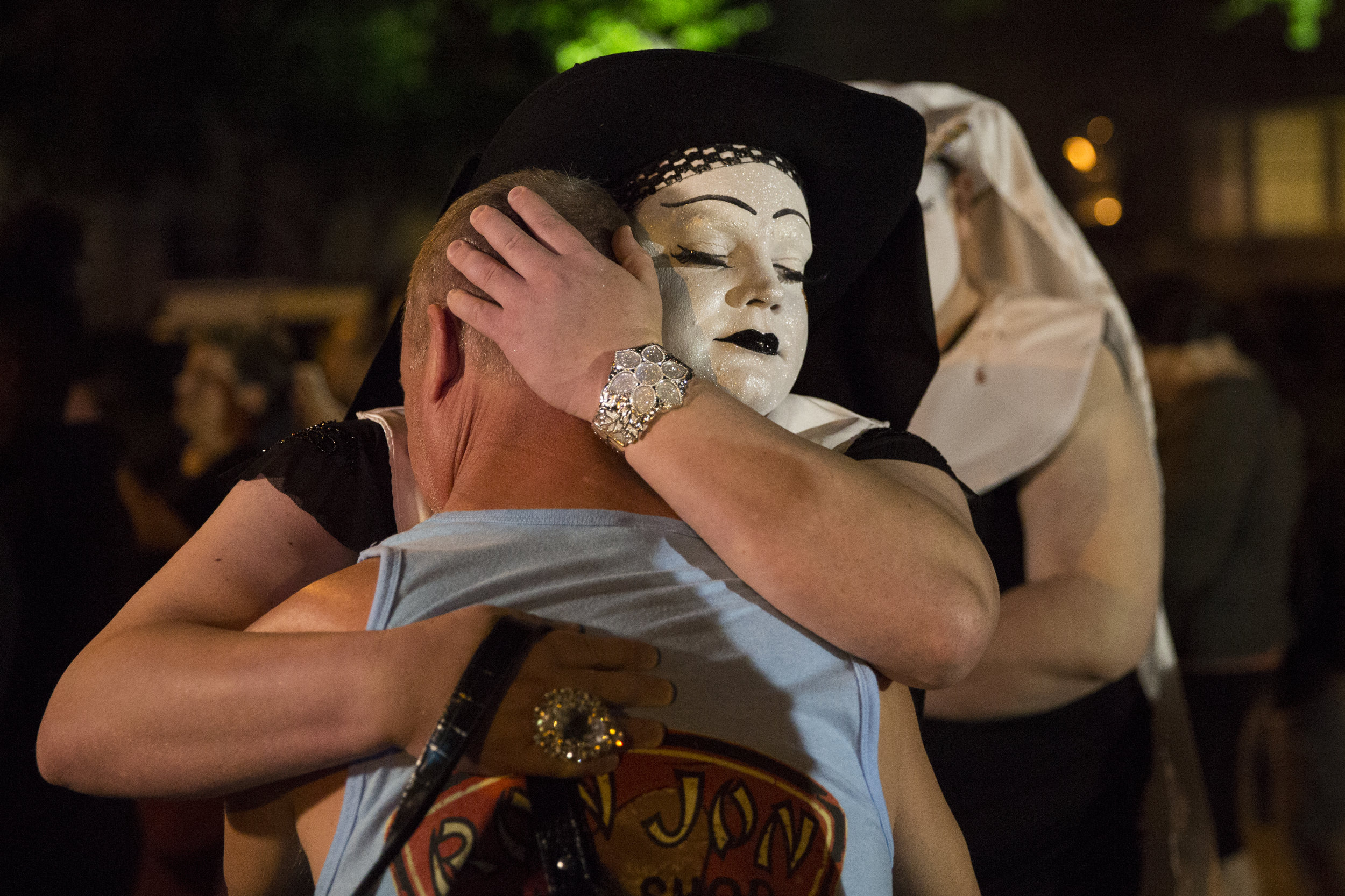 A man is comforted as he is embraced by a Sister of Perpetual Indulgence at a memorial for those killed in the June 2016 Orlando Pulse nightclub massacre.
