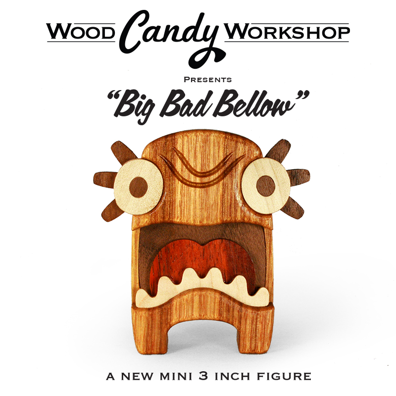 Big Bad Bellow Mini Figure Designed and Handcrafted in Flower Mound Texas Stands 3 inches Tall Comes in a Muslin Sack Hand Rubbed in Satin Finish Oil and Topped off with Beeswax Featuring Canary Wood Body with Padauk, Walnut and Maple Details Limited Edition Releasing at Designer Con